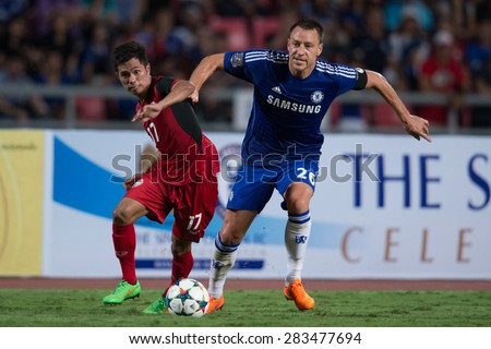 BANGKOK THAILAND MAY 30:John Terry (blue) of Chelsea in action during the Singha Chelsea fc. Celebration match Thailand All-Stars and Chelsea FC Rajamangala Stadium on May 30,2015 in Thailand. - stock photo