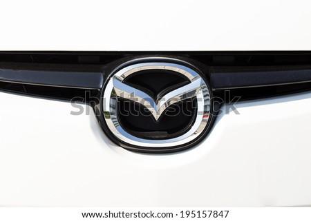 """BANGKOK,THAILAND - MAY 22,2014 : Logo of the brand """"Mazda"""" on car"""