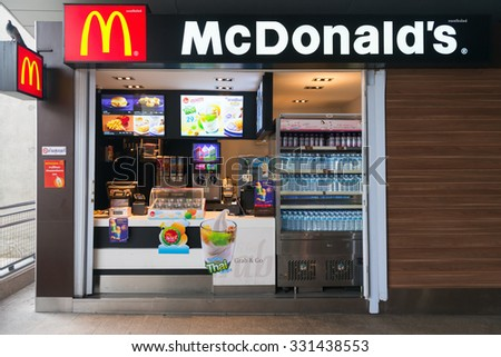 BANGKOK, THAILAND - 07 MAY 2014: Mac Donalds kiosk on BTS Skytrain station, with timber facad, showing drinks food and ice cream