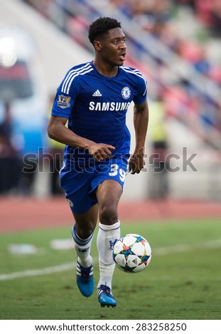 BANGKOK THAILAND MAY 30: Ola Aina of Chelsea run with the ball during the Singha Chelsea fc. Celebration match Thailand All-Stars and Chelsea FC at Rajamangala Stadium on May 30,2015 in Thailand. - stock photo