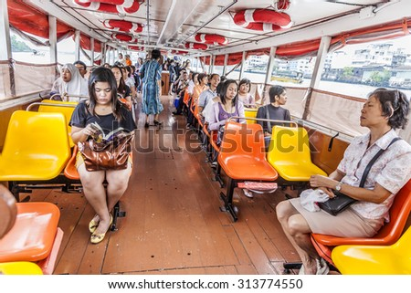 BANGKOK, THAILAND - MAY 12, 2009: people travel by boat in Bangkok, Thailand.  Chao Phraya is a major river in Thailand, low alluvial plain forming the centre of the country. - stock photo