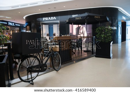 Bangkok, Thailand - May 7, 2016 : Prada store and Paul bakery cafe at Central Embassy Shopping Mall in Bangkok, Thailand.