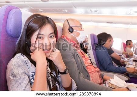 BANGKOK, THAILAND - MAY 21: Smile passengers on board an Thai Airways flight from Suvarnabhumi Airport to Narita Airport on May 21, 2015 - stock photo