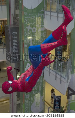 Bangkok, Thailand-May 1st 2014. Spiderman hanging in Centralworld mall, Bangkok. The mall is Bangkok's largest with hundreds of shops. - stock photo