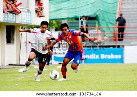 BANGKOK, THAILAND - MAY 26: T. Ruttanabonta (R) in action during Thai Premier League (TPL) between Thai Port FC (O) vs Chainat (W) on May 26, 2012 at PAT Stadium in Bangkok, Thailand