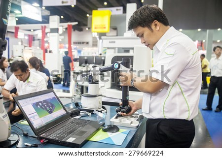 BANGKOK ,THAILAND - MAY 16: Unidentified people use Measuring  instrument for quality inspection in Intermach-Subcon Thailand  2015, on MAY 16, 2015 in Bangkok, Thailand.