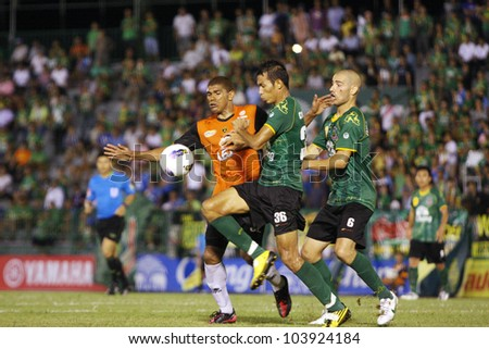 BANGKOK THAILAND - MAY 30 : Unidentified player in Thai Premier League (TPL) between Army Utd (G) VS Changrai (O) at Army stadium on May 30,2012 in Bangkok,Thailand.