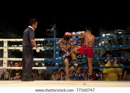 "BANGKOK THAILAND- MAY 18: Unidentified players in Muaythai "" MBK Fight Night"" on May18, 2011 at MBK Shopping Center in Bangkok Thailand - stock photo"