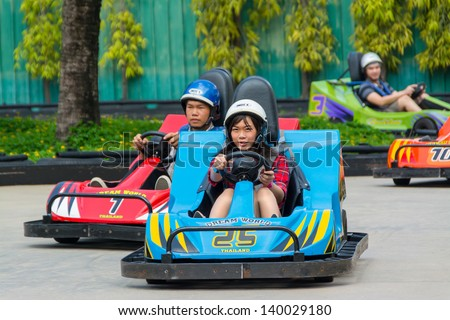 BANGKOK, THAILAND - 10 MAY 2013: unidentified Thai go-kart racing at Dream World on May 10, 2013. Dream world is a famous amusement park in Thailand. - stock photo