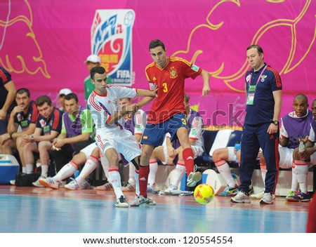BANGKOK, THAILAND - NOV 14:Aicardo of Spain (r) in action during the FIFA Futsal World Cup Quarterfinal Round between Spain and Russia at Nimibutr Stadium on Nov14,2012 in Bangkok, Thailand. - stock photo