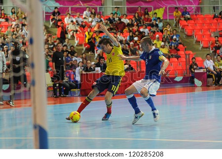 BANGKOK, THAILAND-NOV 18: Alejandro Srena of Colombia (y) in action during the FIFA Futsal World Cup between Italy and Colombia at Indoor Stadium Huamark on Nov18,2012 in Bangkok,Thailand. - stock photo