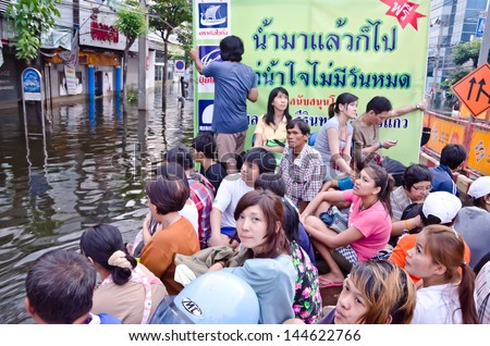 BANGKOK, THAILAND - NOV 5: An army truck takes people from place to place on Jaransanitwong Road during the worst flooding  on November 5, 2011 in Bangkok, Thailand