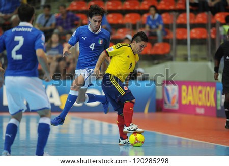BANGKOK, THAILAND-NOV 18: Andres Reyes of Colombia (y) in actionl during the FIFA Futsal World Cup between Italy and Colombia at Indoor Stadium Huamark on Nov18,2012 in Bangkok,Thailand. - stock photo