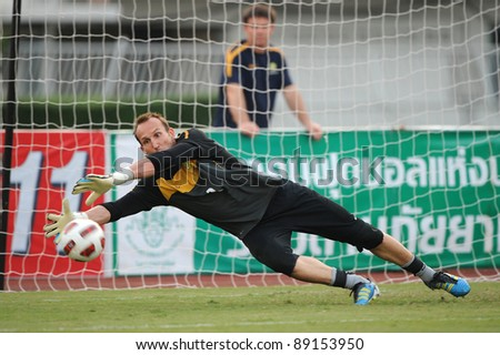 BANGKOK THAILAND - NOV 15:Australian goal keeper Mark Schwazer in action during The FIFA WORLD CUP 2014 between Thailand(B) and Australia (Y) at Supachalasai Stadium on Nov 15, 2011 Bangkok, Thailand. - stock photo
