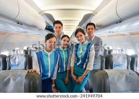 BANGKOK, THAILAND - NOV 11: Bangkok Airways crew members on November 11, 2014. Bangkok Airways is a regional airline based in Bangkok. Its main base is Suvarnabhumi Airport, Bangkok - stock photo