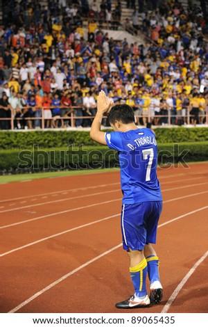 BANGKOK THAILAND - NOV 15: D.Thonglao of Thailand in action during The FIFA WORLD CUP 2014 between Thailand(B) and Australia (Y) at Supachalasai Stadium on Nov 15, 2011 Bangkok, Thailand. - stock photo