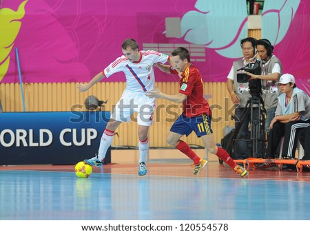 BANGKOK, THAILAND -NOV 14:Dmitrii Prudnikov of Russia (w) in action during the FIFA Futsal World Cup Quarterfinal Round between Spain and Russia at Nimibutr Stadium on Nov14,2012 in Bangkok, Thailand. - stock photo