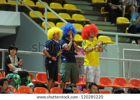 BANGKOK, THAILAND-NOV 18: Fans of Colombia in the FIFA Futsal World Cup between Italy and Colombia at Indoor Stadium Huamark on Nov18,2012 in Bangkok,Thailand. - stock photo