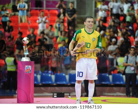 BANGKOK, THAILAND - NOV 18: Fernandinho of Brazil is seen with the adidas Bronze Boot Award after the FIFA Futsal World Cup Final at Indoor Stadium Huamark on November 18, 2012 in Bangkok, Thailand. - stock photo