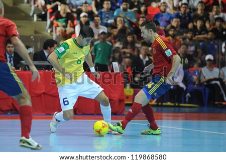 BANGKOK, THAILAND - NOV 18 : Gabriel of Brazil during action in FIFA Futsal World Cup thailand 2012 Between Spain (R) VS Brazil (Y) on November 18, 2012 at Indoor Stadium Huamark in Bangkok Thailand. - stock photo