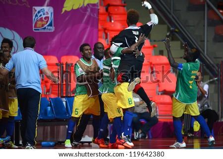 BANGKOK,THAILAND-NOV 09:Goalkeeper Anthony Talo of Solomon Islands celebrates during the FIFA Futsal World Cup between Solomon Islands and Guatemala at Indoor Stadium Huamark on Nov9,2012 in,Thailand. - stock photo