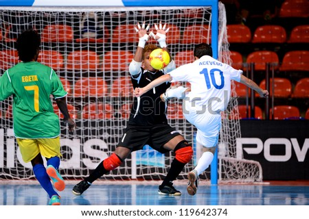 BANGKOK,THAILAND-NOV 09:Goalkeeper Anthony Talo of Solomon Islands in action during the FIFA Futsal World Cup between Solomon Islands and Guatemala at Indoor Stadium Huamark on Nov9,2012 in,Thailand. - stock photo
