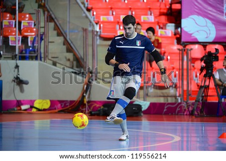 BANGKOK,THAILAND-NOV18:Goalkeeper Stefano Mammarella of Italy warms up ahead during the FIFA Futsal World Cup  between Italy and Colombia at Indoor Stadium Huamark on Nov18,2012 in,Thailand. - stock photo