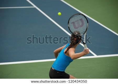 BANGKOK,THAILAND-NOV  29  : Hong Kong tennis player Wing-Yau Venise Chan returns a serve at semi final match in Chang ITF Pro Circuit 2012 on November 29,2012 at Rama Garden Hotel in Bangkok,Thailand. - stock photo