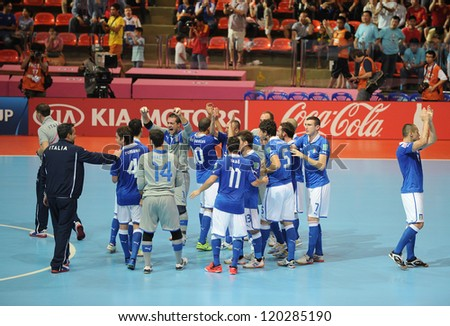 BANGKOK,THAILAND-NOV 18:Italy team celebrates after defeating Colombia during the FIFA Futsal World Cup 3rd place match between Italy and Colombia at Indoor Stadium Huamark on Nov18, 2012 in Thailand. - stock photo
