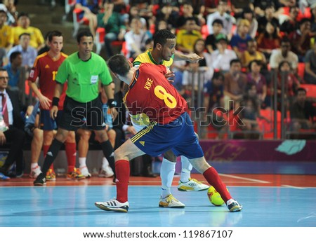 BANGKOK, THAILAND - NOV 18 : Je of Brazil during action in FIFA Futsal World Cup thailand 2012 Between Spain (R) VS Brazil (Y) on November 18, 2012 at Indoor Stadium Huamark in Bangkok Thailand.