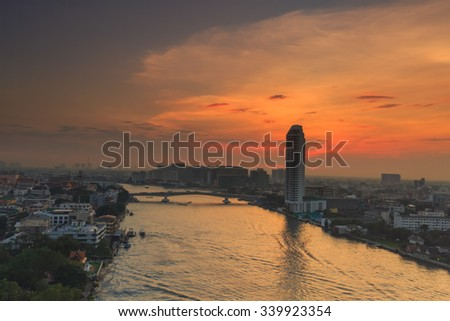 Bangkok,Thailand-Nov 16.Junladit river costly condominium at dusk with Chao Phraya river with cloud and sun raise on Nov 16,2015