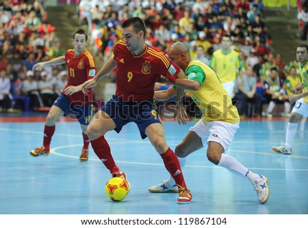 BANGKOK, THAILAND - NOV 18 : Lozano of Spain during action in FIFA Futsal World Cup thailand 2012 Between Spain (R) VS Brazil (Y) on November 18, 2012 at Indoor Stadium Huamark in Bangkok Thailand. - stock photo