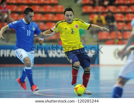BANGKOK, THAILAND-NOV 18: Luis Berrenche of Colombia (y) in action during the FIFA Futsal World Cup between Italy and Colombia at Indoor Stadium Huamark on Nov18,2012 in Bangkok,Thailand.