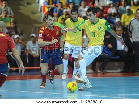BANGKOK, THAILAND - NOV 18 : Neto of Brazil durin action in FIFA Futsal World Cup thailand 2012 Between Spain (R) VS Brazil (Y) on November 18, 2012 at Indoor Stadium Huamark in Bangkok Thailand. - stock photo