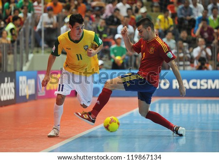 BANGKOK, THAILAND - NOV 18 : Neto of Brazil during action in FIFA Futsal World Cup thailand 2012 Between Spain (R) VS Brazil (Y) on November 18, 2012 at Indoor Stadium Huamark in Bangkok Thailand. - stock photo