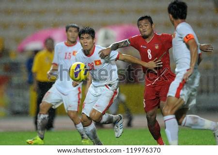 BANGKOK THAILAND-NOV 24:Nguyen Gia Tu#26 of Vietnam (white) in action during the AFF Suzuki Cup between Vietnam and Myanmar at Rajamangala stadium on Nov24, 2012 in Bangkok,Thailand.