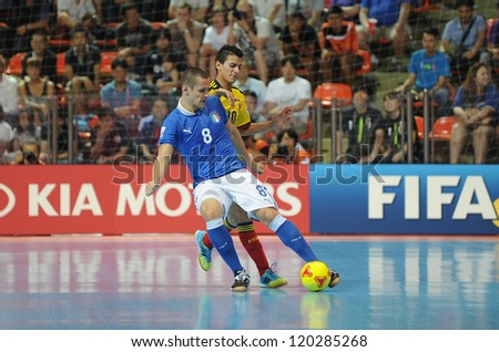 BANGKOK, THAILAND-NOV 18: Rodolfo Fortino of Italy (b) in action during the FIFA Futsal World Cup between Italy and Colombia at Indoor Stadium Huamark on Nov18,2012 in Bangkok,Thailand. - stock photo