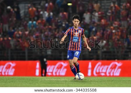 BANGKOK THAILAND-NOV22:Siwakorn Jakkuprasat(R) of Thai Port Fcin action during Thai Premier League2015 between Thai Port Fc and Osotspa FCat PAT Stadium on November22,2015 in Bangkok Thailand - stock photo