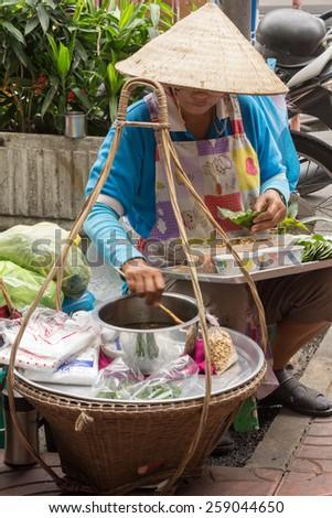 Bangkok, Thailand Nov 28th 2014: A vendor preparing betel nut wraps (Miang Kham). This is a popular snack amongst the Thais. - stock photo