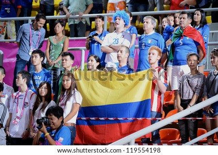 BANGKOK,THAILAND-NOV18:Unidentified fans of Colombia supporters  during the FIFA Futsal World Cup  between Italy and Colombia at Indoor Stadium Huamark on Nov18,2012 in,Thailand. - stock photo