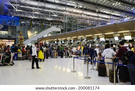BANGKOK, THAILAND - NOV 21: Unidentified passengers arrive at the check-in counters at the new Suvarnabhumi Airport, November 21, 2013 in Bangkok, Thailand. The airport is one of the busiest in Asia. - stock photo