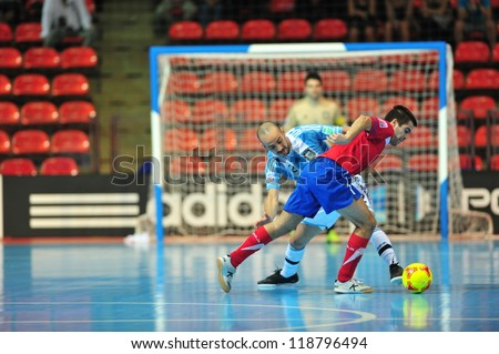 BANGKOK, THAILAND - NOV 12 : Unidentified players in FIFA Futsal World Cup Round of 16 match between Serbia (R) and Argentina (B) at Indoor Stadium Huamark on November 12, 2012 in Bangkok, Thailand - stock photo