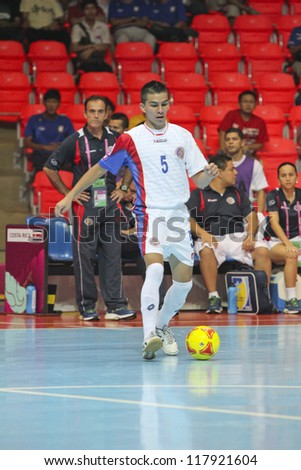 BANGKOK, THAILAND - NOV 04 : Unidentified players in FIFA Futsal World Cup thailand 2012 Between Paraguay (R) VS Costa Rica (W) at Indoor Stadium Huamark on November 4, 2012 in Bangkok, Thailand. - stock photo
