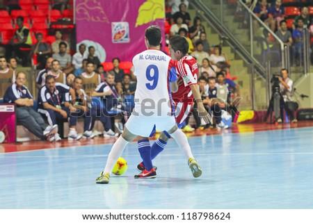 BANGKOK, THAILAND - NOV 04 : Unidentified players in FIFA Futsal World Cup thailand 2012 Between Paraguay (R) VS Costa Rica (W) at Indoor Stadium Huamark on November 4, 2012 in Bangkok, Thailand. - stock photo