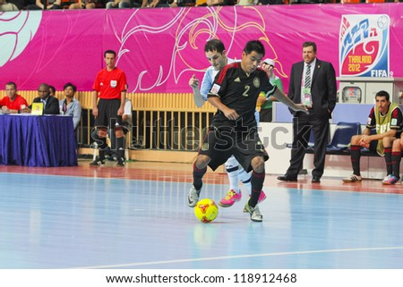 BANGKOK, THAILAND - NOV 2 : Unidentified players in FIFA Futsal World Cup thailand 2012 Between Argentina (Blue) VS Mexico (Black) on November 2, 2012 at Nimibutr Stadium in Bangkok Thailand. - stock photo