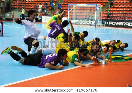 BANGKOK, THAILAND - NOV 18: Vinicius of Brazil celebrates with team mates after winning the FIFA Futsal World Cup Final at Indoor Stadium Huamark on November 18, 2012 in Bangkok, Thailand.