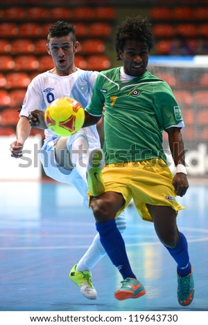 BANGKOK,THAILAND-NOV 09: Walter Enriquez of Guatemala (white) in action during the FIFA Futsal World Cup between Solomon Islands and Guatemala at Indoor Stadium Huamark on Nov9,2012 in,Thailand.