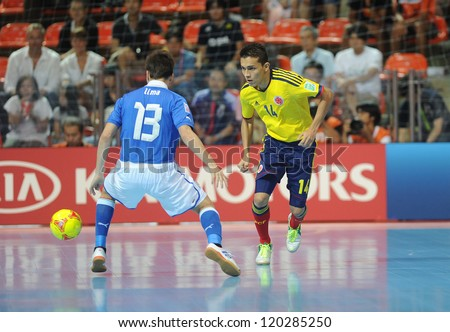 BANGKOK, THAILAND-NOV 18:Yeissen Fonnegra of Colombia (y) in actionl during the FIFA Futsal World Cup between Italy and Colombia at Indoor Stadium Huamark on Nov18,2012 in Bangkok,Thailand. - stock photo