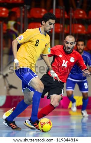 BANGKOK,THAILAND-NOVEMBER 09:Abdulrahman Alwadi of  Kuwait (yellow) in action during the FIFA Futsal World Cup between Kuwait and Egypt at Indoor Stadium Huamark on Nov9,2012 in Bangkok,Thailand. - stock photo