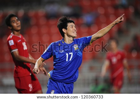 BANGKOK THAILAND-NOVEMBER 27:Apipoo Suntornpanavej of Thailand celebrates after scoring during the AFF Suzuki Cup between Thailand and Myanmar at Rajamangala stadium on Nov27,2012 in Bangkok,Thailand.